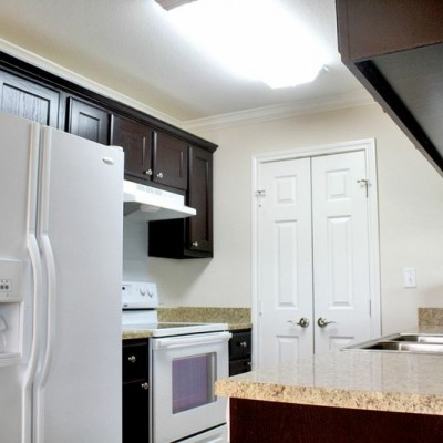Kitchen with fridge, oven, sink and microwave