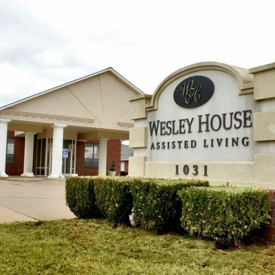Wesley House Assisted Living sign in front of building