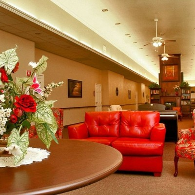 Long common area with red couch and chairs